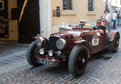 Cars of the Mille Miglia in narrow city streets